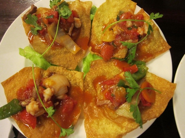 ... tomato, and onion with sauce and served on a flat wonton. This one